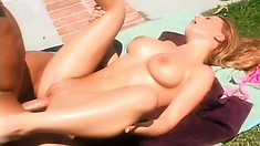 Ravishing blonde with perfect boobs and ass enjoys a deep pounding by the pool