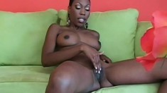 Black beauty Cherry lies on the sofa and makes herself cum with a dildo