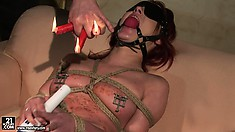 Hot BDSM action with redhead in bondage vibing her twat and getting waxed