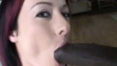 Young redheaded tart goes down on a lucky dude's thick black dong