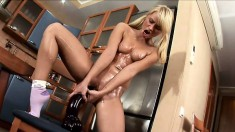 Sexy Michelle oils up her body and plays with a monstrous toy