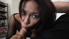 Ravishing Asian babe Lacy Thom works her sweet lips on a long shaft