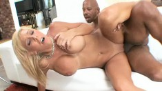 Big breasted blonde milf Misty Vonage knows her way around a huge dick