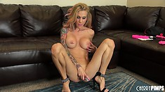 Tattooed bitch Sarah fingers and gets on the floor for more toying