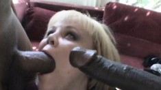 Curvaceous blonde in stockings has two black guys punishing her holes