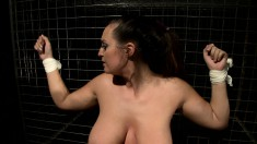 Big breasted hottie with a wonderful ass gets all tied up and punished