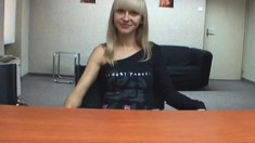 Petite blonde gets undressed and takes a bulging boner in her hands