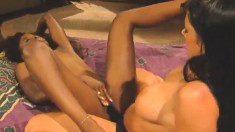 Tight-bodied ebony lesbian gets her tight twat stretched with a strap-on