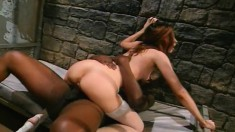 Redhead Gwen Summers is behind bars and gets drilled by black dick