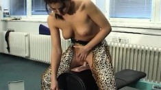 Sensuous brunette jumps on top of the sybian and rides it with fervor