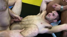 Three horny musclemen warm up in the gym with hot cocksucking and ass fucking