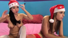 Smoking hotties Carmen Caliente and Kimmy Lee share a cock in a Christmas three-way