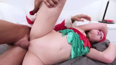 Dirty babe in an elf costume can't wait to fuck this hung Santa