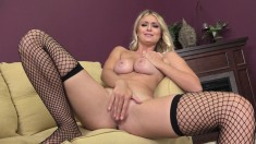 Busty babe in fishnet stockings has a tight cunt yearning for pleasure