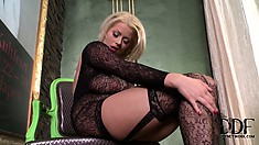 Stunning blonde beauty strikes poses in flashy black lingerie