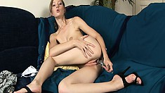 Dasha's puffy pussy gobbles up her favorite glass dildo on the couch