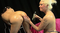 Sexy lesbians get oiled up, her wet pussy gets a fist put inside