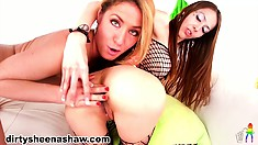 A blonde and a brunette embark on a lesbian journey with some sex toys for company