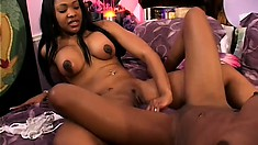 Three black chicks hook up on the bed and use a huge dildo to fulfill their needs