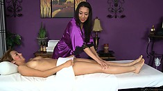 Hot brunette babe massaging her friend in a sexy and sensual lesbian massage video