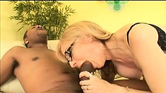 Blond babe in black bra and stockings fuck and suck his big cock