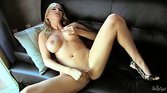 Big tit blonde spreads 'em wide to slip her fingers in her cock box