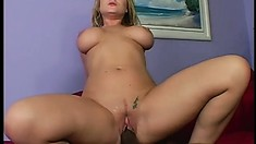 Curvaceous blonde milf has a black stud fucking her wet pussy all over the couch