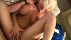 Buxom blonde cheerleader jumps on top of her man and rides his big cock