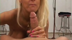 Sexy blonde Milf gets two studs working her over and she eats a warm load