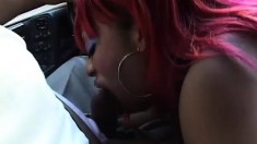 Lethal Lipps shows off her oral skills by giving head in a car