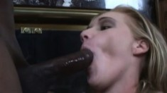 Lustful blonde seduces a black guy and takes his huge cock in her holes
