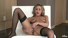 Beautiful blonde in sexy thigh stockings fucks herself with a sex toy