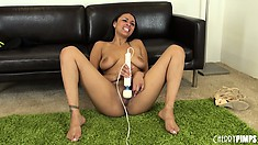 Bethany Benz purrs softly while working on her clit with a vibe