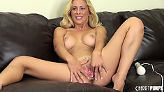Cherie Deville enjoys using her vibrator on the leather couch