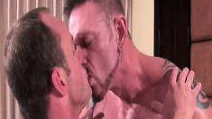 Inked up dude with exotic piercings gets licked and pounded raw