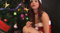 Asian Bitch Dressed Like A Slutty Santa Shows Off Her Great Tits