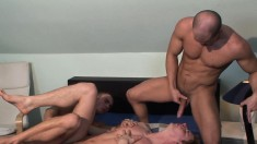 Gorgeous young stud has two lustful guys taking turns banging his ass