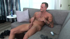Muscled hunk Zack Matthews loses his clothes and jacks off on the sofa