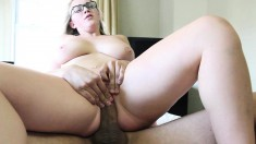Curvaceous blonde girl with glasses fucks a big dick all over the bed