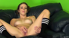 Kimbey spreads her sexy body across the black couch and fingers her tight snatch