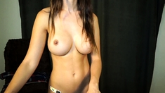 Busty Brunette Undresses And Poses Softcore In Kitchen