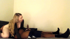 Amateur wife gives an interracial cuckold handjob
