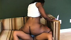 Ebony bitches use a massive strap-on while fucking on the couch