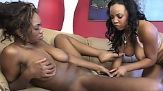She slides that black dildo in and out of her lover's wet cunt
