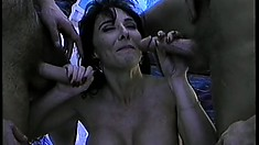 Sexy brunette with big boobs has two guys roughly fucking her holes by the pool