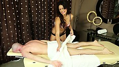 Sexy masseuse gives a bald guy a nice rubdown in her lingerie