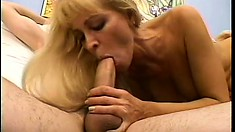 Milf blonde Nicole Moore blows, rides his pecker and gets cum on her titties