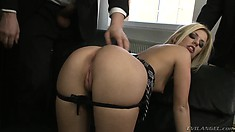 Jessie Volt shows off her fine ass and gets three cocks pounding her holes