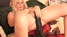 Hot blonde mom has a huge dildo and a big black cock banging her holes