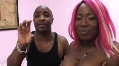 Kelly Reigns takes a big black rod deep in her ebony pussy from behind